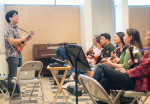 Jason Arimoto leads an intermediate ukulele class. Photo by M Palma.