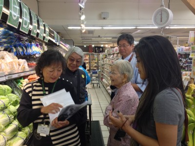 JANM volunteer, Roxana enlightens the group with facts about various Japanese vegetables.