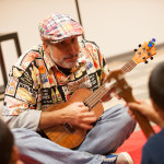 "George ""Gibi"" del Barrio (Grandpa Geebz) led strum-along and sing-along workshops for the little ones. Photo by M Palma."