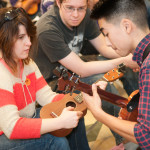 Lucky students get instruction by Tj Mayeshiro during one of the intermediate ukulele classes. Photo by M Palma.