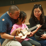 The entire family enjoyed the ukulele workshops. Photo by M Palma.