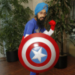 Cartoonist Vishavjit Singh shared the reactions he received as he dressed up as Sikh Captain America and was photographed around NYC. Photo by Russell Kitagawa