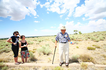 A family returns to the site of their former barrack at Amache. Photo: Tracy Kumono.