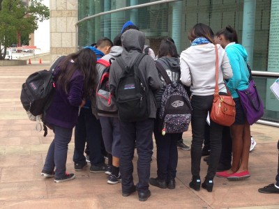 Staci Yamanishi's eighth-grade students discover her name engraved on JANM's Children's Courtyard.