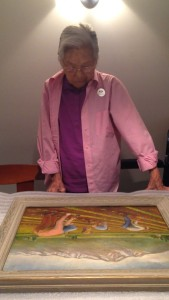 My grandmother looking at a painting in which she is depicted.