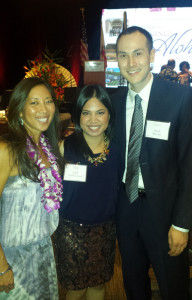 New JANM staff member Mark Robbins, right, attends the Go For Broke National Education Center's 14th Annual Evening of Aloha Gala Dinner with his wife, Iryll Robbins-Umel, center. At left is keynote speaker and pioneering Asian American athlete Natalie Nakase.