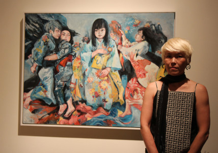 Artist Mari Inukai in front of her painting. Photo by Richard Murakami.