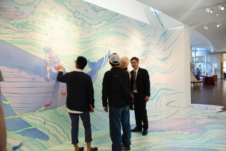 Eric Nakamura, right, and a few of the artists admire kozyndan's mural. Photo by Nobuyuki Okada.