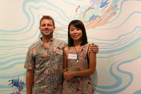 Kozue and Dan Kitchens, aka kozyndan, pose in front of their work. Photo by Nobuyuki Okada.