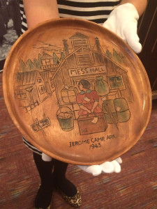 A carved wood plate by Henry Sugimoto, now part of the museum's permanent collection. Photo by Nicole Miyahara.