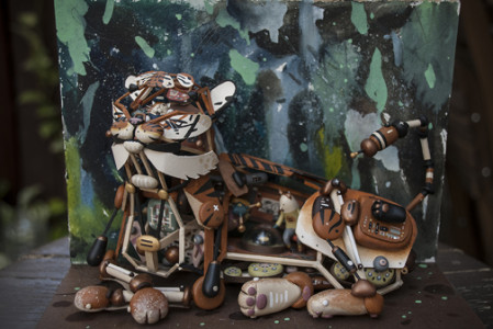 Sean Chao, Big Cat, 2015, bass wood, polymer clay, acrylic, and gouache paint on wood panel. Photo courtesy of the artist.