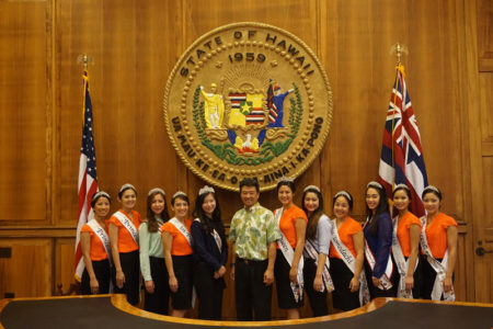 The 2015 Nisei Week Court and the 2015 Northern California Cherry Blossom Festival Court visit Lieutenant Governor Shan Tsutsui at the Hawai'i State Capitol.