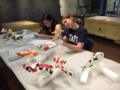 Kelly and Christina making sure the origami carp are in good shape. Photo: Vicky Murakami.