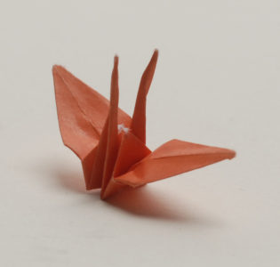 An original crane folded by Sadako Sasaki, now on view at JANM. Photo by Norman Sugimoto.